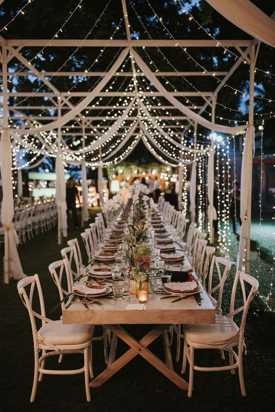 outdoor wedding florals and fairy lights